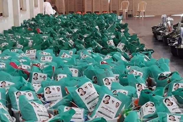 ADMK again stick  stickers on relief materials