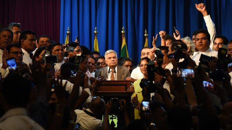 Ending  51 days power tussle Wickremesinghe returns to power in Srilanka
